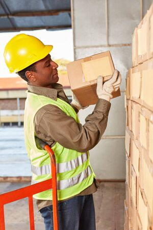 Logistics worker in online trade. Shipping prepares package for delivery