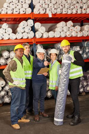 Group warehouse worker as a logistics team works together in a warehouse Stockfoto