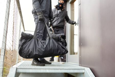 Two burglars escape with bag full of loot from office Stok Fotoğraf