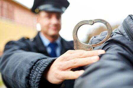Policeman handcuffing criminals