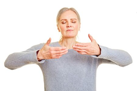 Elderly woman is doing exercise to breathe freely