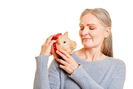 Elderly woman carries a piggy bank on the shoulder