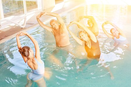 Senior group on aquagym or hydrotherapy