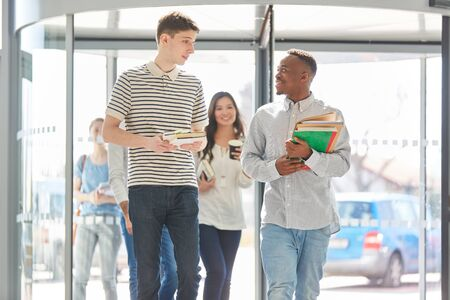 Interracial group or team of students with books in university Stock fotó - 131352718