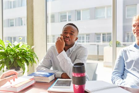 African student in study group at university classroom