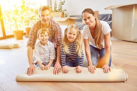 Parents and children roll carpet when moving to the new family home