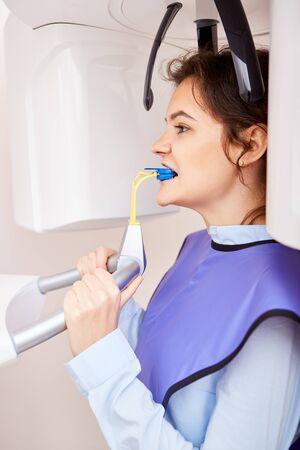 Woman as a patient with the dental X-ray at the dentist 版權商用圖片