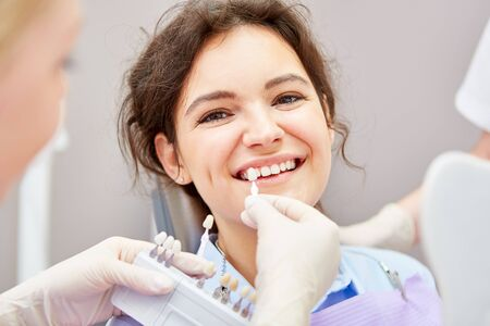 Smiling woman with professional teeth whitening at the dentist