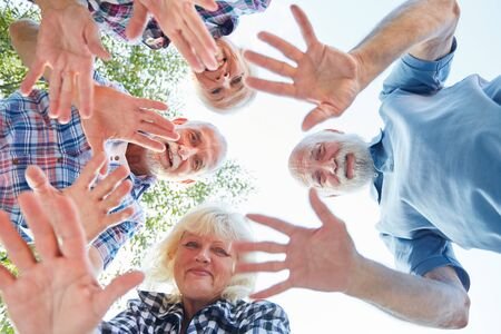 Waving hands of seniors in summer. Vacation on a tour Stock fotó