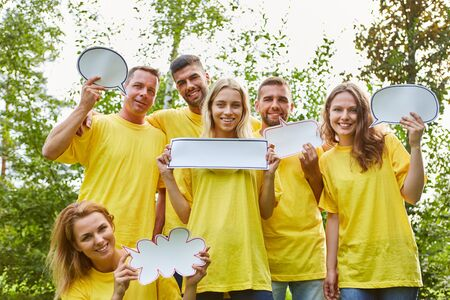 Creative young startup team showing speech bubbles as a brainstorming method Stock Photo