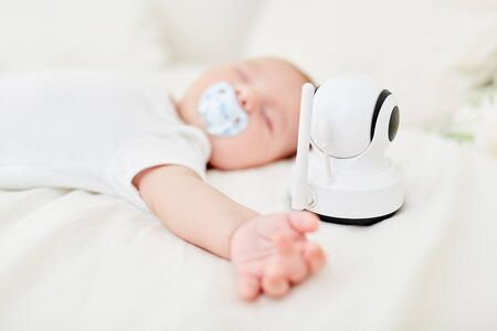 Baby is monitored in sleep and controlled with baby monitor vibration alert 스톡 콘텐츠