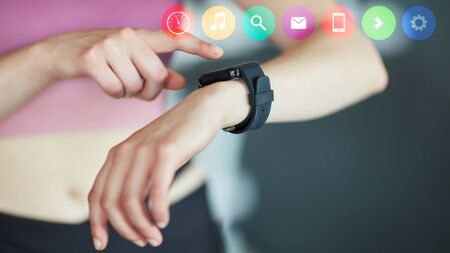 Woman uses menu of smart watch as communication concept