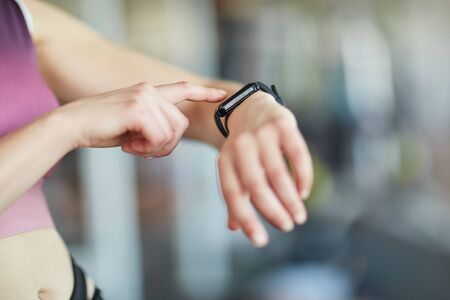 Woman with wearable smart watch to control heart rate and heart rate