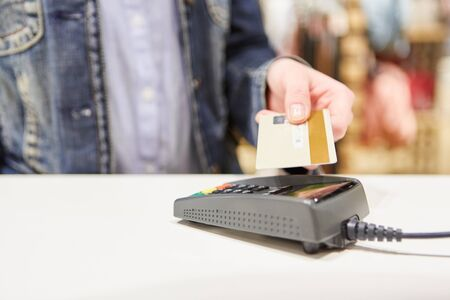 Customer pays cashless and makes mobile payment with cash card at checkout