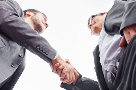 Handshake between business partners as a sign of contract and cooperation