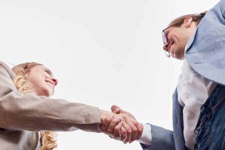 Business partners shake hands as a sign of greeting or agreement 写真素材