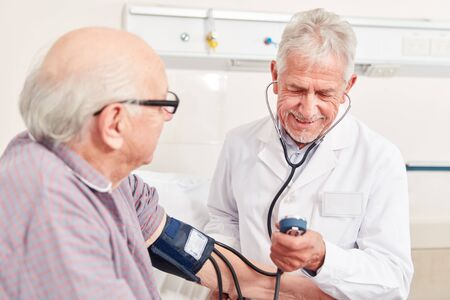 Experienced doctor measures the blood pressure of a senior man as a precautionary measure