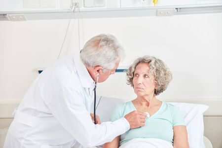 Doctor examining a patient with the stethoscope in the hospital