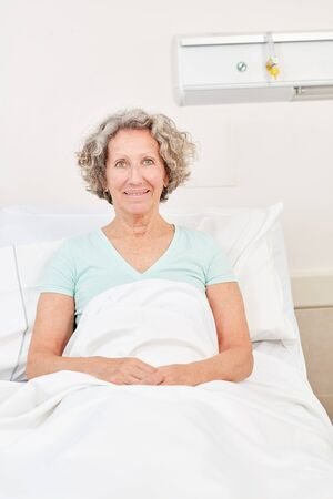 Senior as a satisfied patient in a rehab clinic in the hospital bed