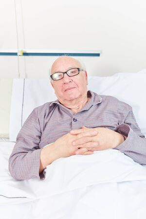 Senior man as a bedridden patient in a nursing home or retirement home Reklamní fotografie