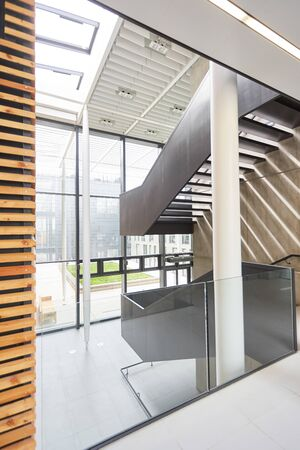Open staircase in a modern office building 写真素材 - 133704724