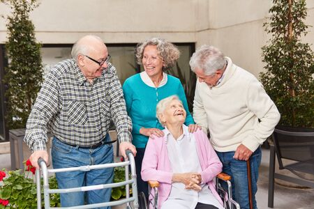 Seniors as friends together in the retirement home or the senior residence