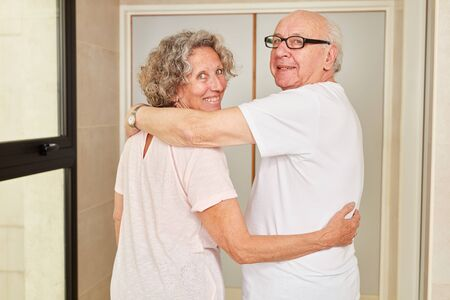 Happy senior couple hugging each other in retirement at the retirement home Reklamní fotografie