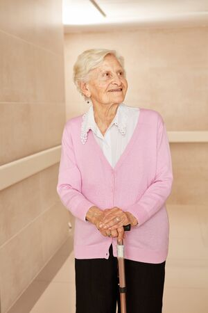 Senior with crutch in a nursing home or nursing home Reklamní fotografie