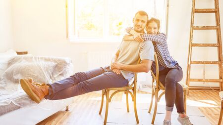Happy young couple renovating after moving to new home