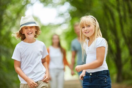 Boy and girl have fun walking with the family