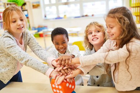 Group children strengthens the team spirit and motivation with hands stacking