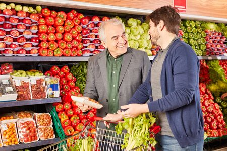 Pensioner and son shopping together at the grocery store in the supermarket