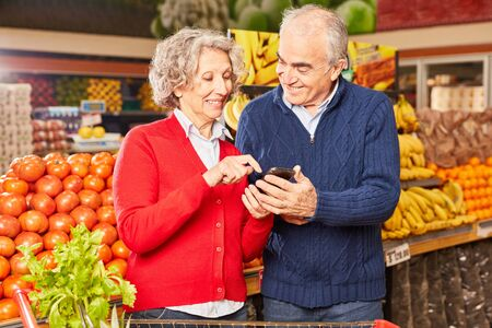 Seniors with smartphone app for information about food and price comparison