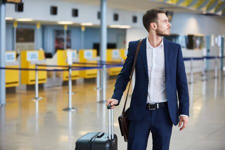 Business man on business trip in the airport terminal on arrival or when changing trains
