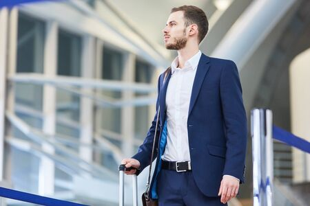 Young businessman as a passenger on arrival or while changing in the airport Zdjęcie Seryjne