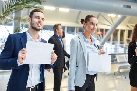 Business people with blank name tags for the guest to pick up as a service Zdjęcie Seryjne