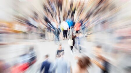 Zoom on anonymous crowd at a trade show or in the mall