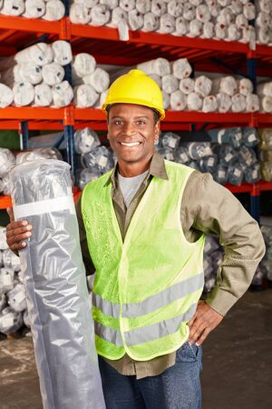 Logistics Apprentice in training as a warehouse specialist with delivery in the warehouse
