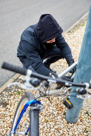 Bicycle thief on bicycle steal in the city Stock Photo