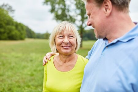 Happy senior couple in love walking while walking in the park in summer Stok Fotoğraf