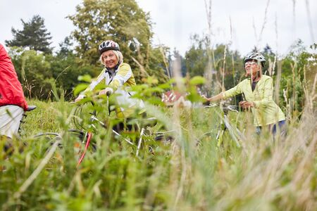 Group of seniors cycling in nature on a bike ride or bike ride Stok Fotoğraf