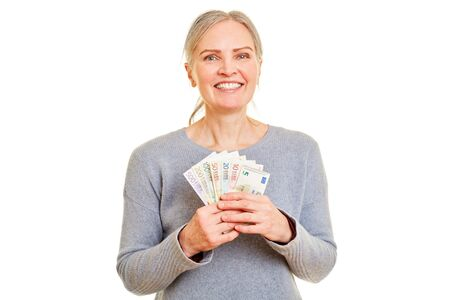 Happy senior woman as winner of Euro banknotes