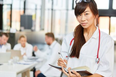 Young Asian woman as a nurse or a doctor in scheduling