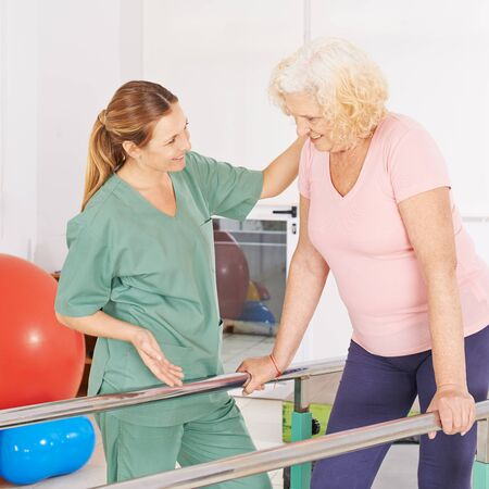 Physiotherapist makes physiotherapy with an old woman on the treadmill