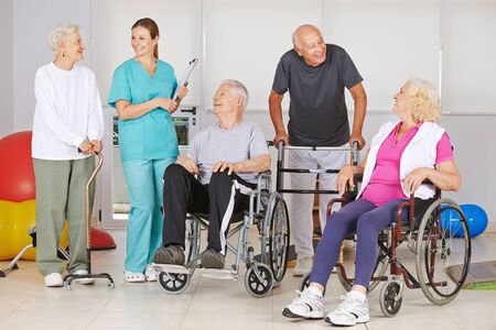Physiotherapy with a group of seniors and nurse in the nursing home