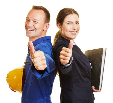 Happy worker and happy employees holding the thumbs up together