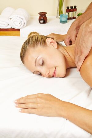 Young woman gets a relaxing neck massage in the day spa