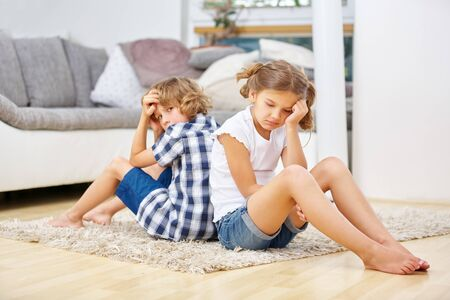 Two siblings are silent after arguing in the living room Reklamní fotografie
