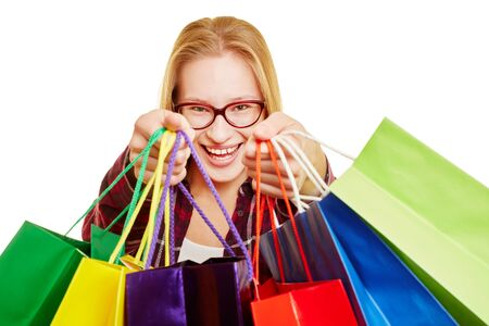 Young woman shopping with lots of colorful shopping bags Reklamní fotografie