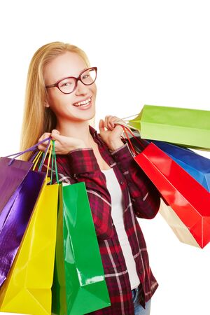 Young woman smiles with lots of colorful shopping bags in her hands Reklamní fotografie